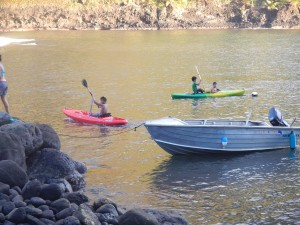 Local kids loved borrowing the kayaks of the cruisers. They would bring us fruit for the privilege.